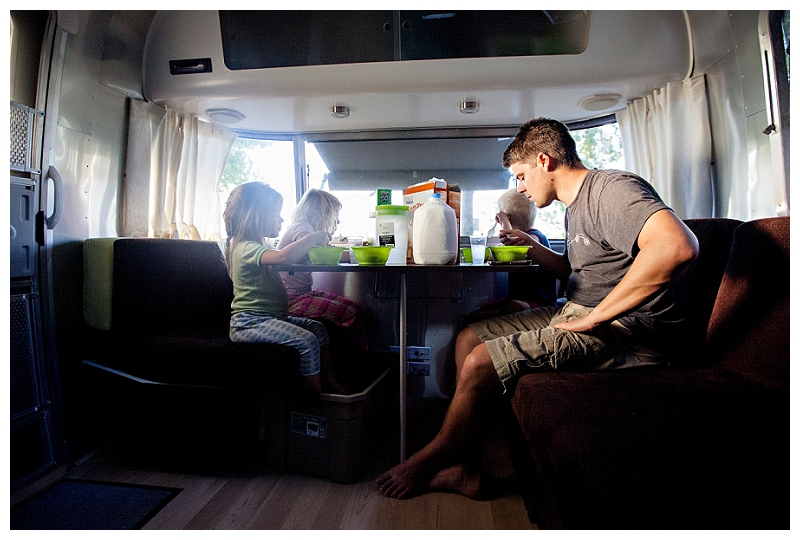family eating breakfast in an Airstream