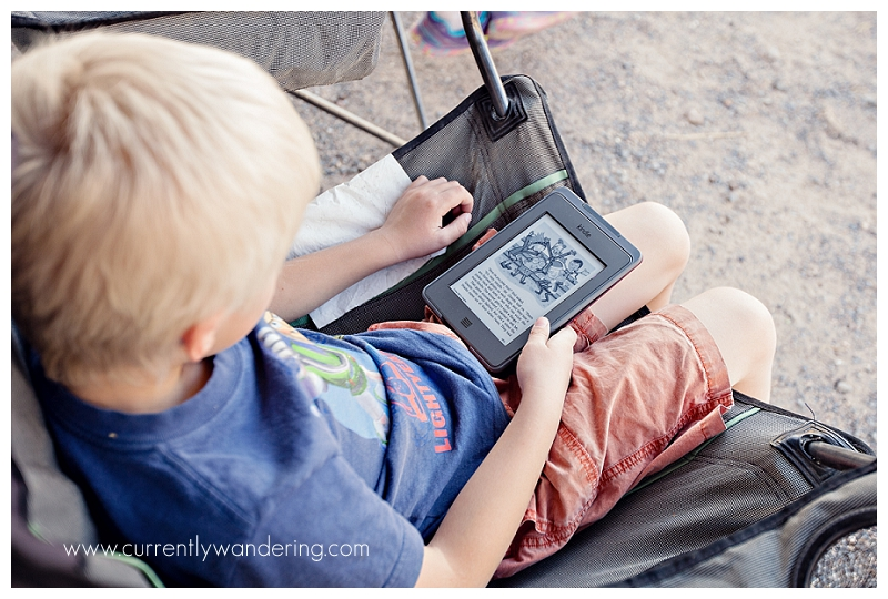 Young Boy Reading Kindle